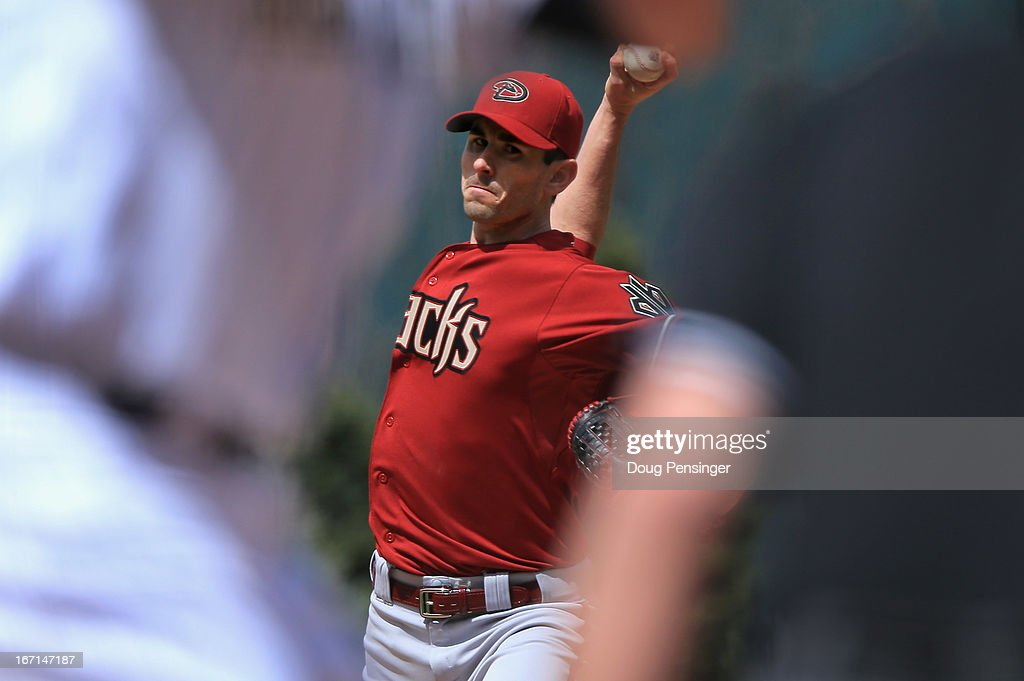 Starting pitcher <a gi-track='captionPersonalityLinkClicked' href=/galleries/search?phrase=Brandon+McCarthy&family=editorial&specificpeople=224849 ng-click='$event.stopPropagation()'>Brandon McCarthy</a> #32 of the Arizona Diamondbacks delivers against the Colorado Rockies at Coors Field on April 21, 2013 in Denver, Colorado.