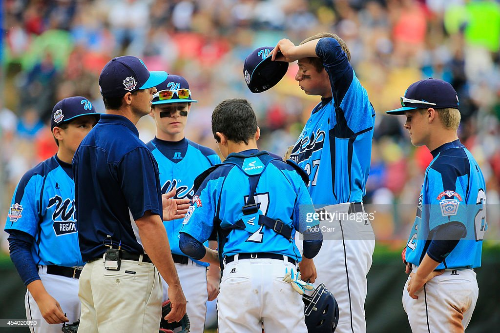 Starting pitcher Brennan Holligan #27 of of the West Team from Las Vegas, Nevada talks with the team on the mound after giving up a run against the Great Lakes Team from Chicago, Illinois during the United States Championship game of the Little League World Series at Lamade Stadium on August 23, 2014 in South Williamsport, Pennsylvania.
