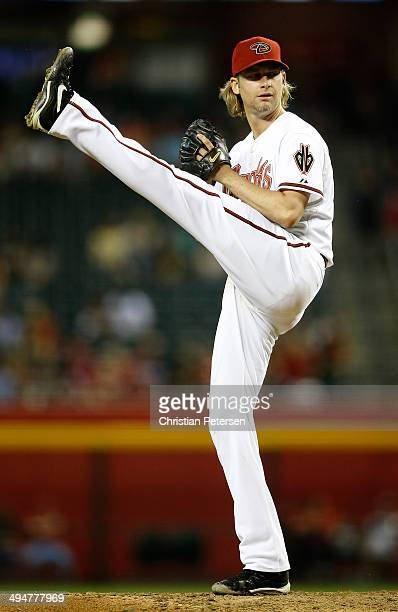 Starting pitcher Bronson Arroyo of the Arizona Diamondbacks pitches against the Cincinnati Reds during the MLB game at Chase Field on May 30 2014 in...