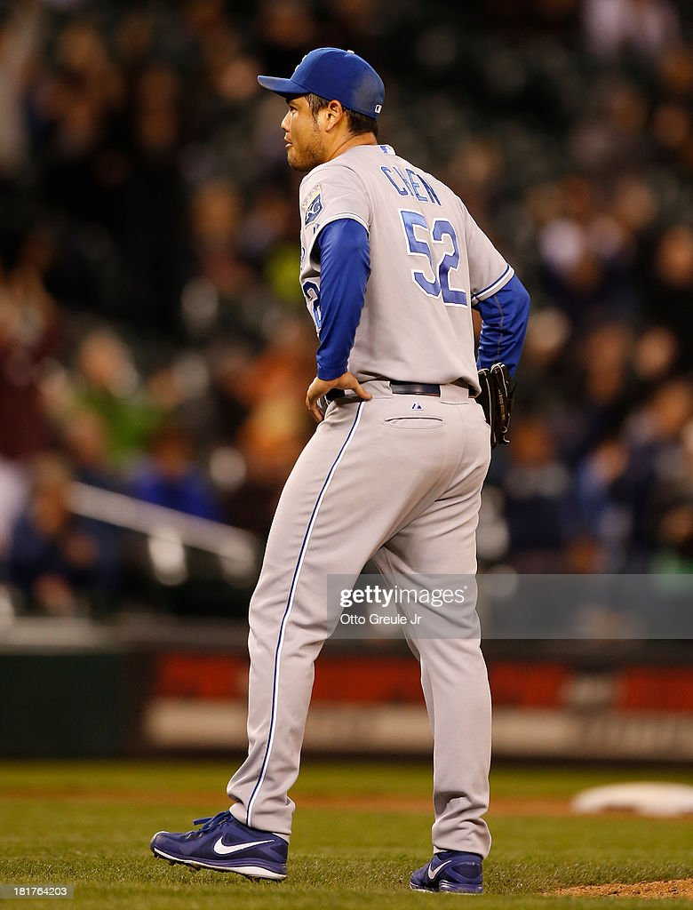 Starting pitcher <a gi-track='captionPersonalityLinkClicked' href=/galleries/search?phrase=Bruce+Chen&family=editorial&specificpeople=213886 ng-click='$event.stopPropagation()'>Bruce Chen</a> #52 of the Kansas City Royals reacts after giving up a three-run homer to Justin Smoak of the Seattle Mariners in the fifth inning at Safeco Field on September 24, 2013 in Seattle, Washington.