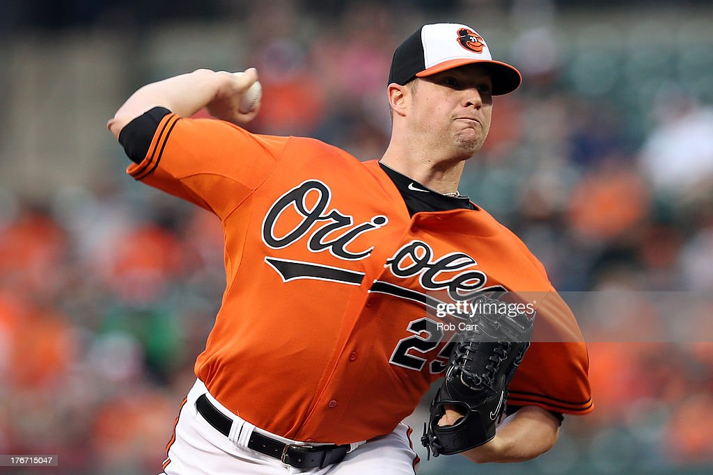 Starting pitcher <a gi-track='captionPersonalityLinkClicked' href=/galleries/search?phrase=Bud+Norris&family=editorial&specificpeople=5746311 ng-click='$event.stopPropagation()'>Bud Norris</a> #25 of the Baltimore Orioles throws to a Colorado Rockies batter during the first inning at Oriole Park at Camden Yards on August 17, 2013 in Baltimore, Maryland.