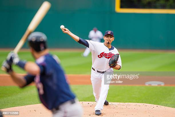 Starting pitcher Carlos Carrasco of the Cleveland Indians pitches to Joe Mauer of the Minnesota Twins during the first inning of game one of a double...