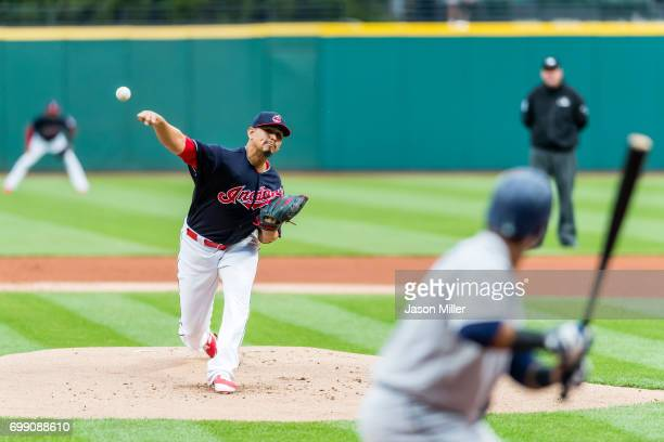 Starting pitcher Carlos Carrasco of the Cleveland Indians pitches to Jean Segura of the Seattle Mariners during the first inning against the Seattle...