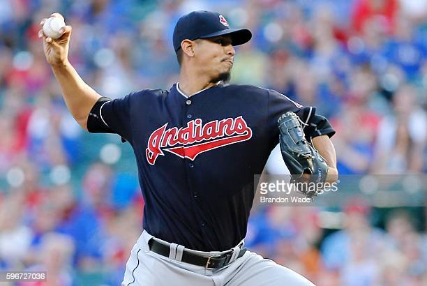 Starting pitcher Carlos Carrasco of the Cleveland Indians throws during the first inning of a baseball game against the Texas Rangers at Globe Life...