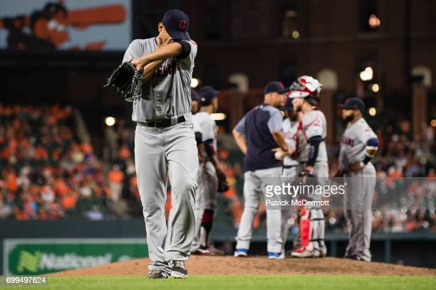 Starting pitcher Carlos Carrasco of the Cleveland Indians walks back to the dugout after being relieved in the seventh inning during a game against...