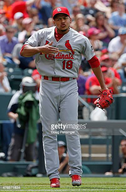 Starting pitcher Carlos Martinez of the St Louis Cardinals celebrates as his teammates turn a double play on the Colorado Rockies to end the fifth...