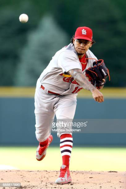 Starting pitcher Carlos Martinez of the St Louis Cardinals throws in the first inning against the Colorado Rockies at Coors Field on May 26 2017 in...