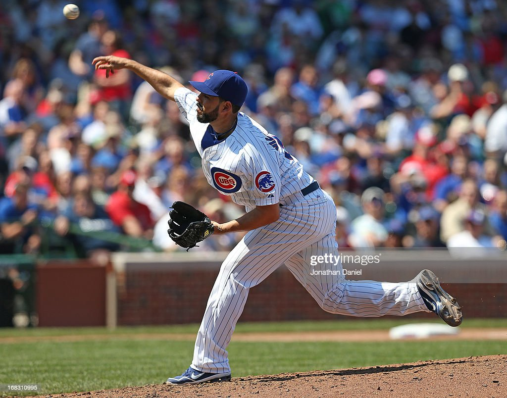 Starting pitcher Carlos Villanueva #33 of the Chicago Cubs delivers the ball against the St. Louis Cardinals at Wrigley Field on May 8, 2013 in Chicago, Illinois.