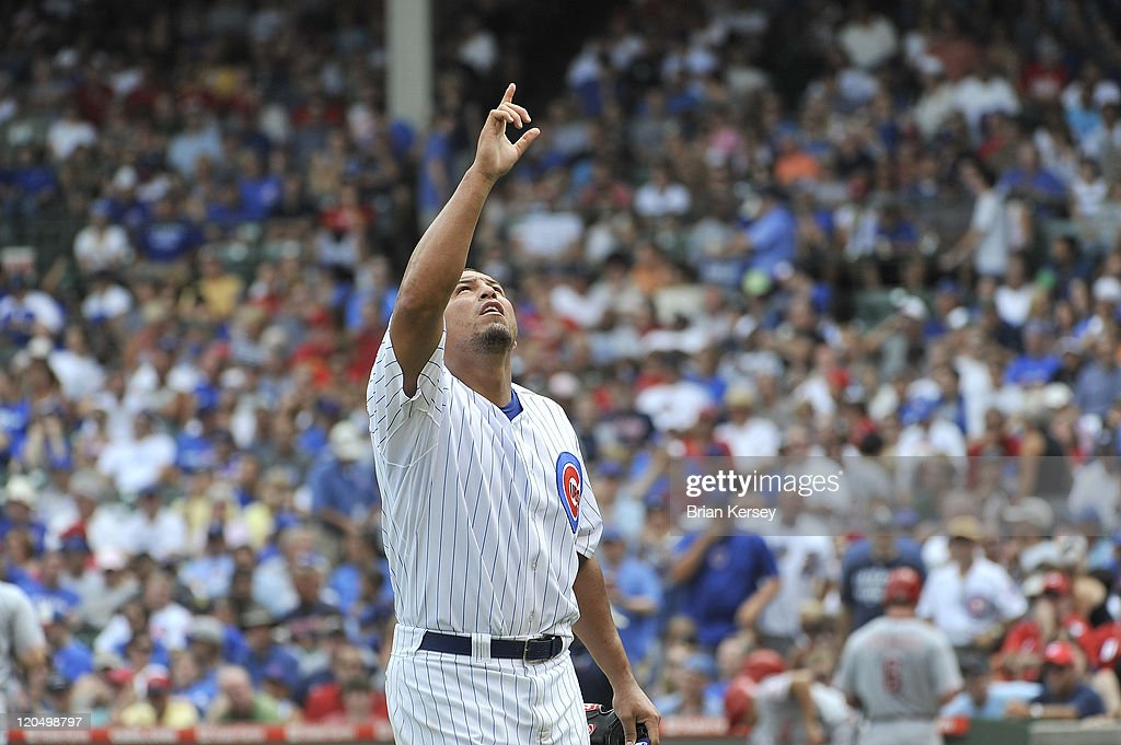 Starting pitcher <a gi-track='captionPersonalityLinkClicked' href=/galleries/search?phrase=Carlos+Zambrano&family=editorial&specificpeople=203225 ng-click='$event.stopPropagation()'>Carlos Zambrano</a> #38 of the Chicago Cubs points to the sky after finishing the sixth inning against the Cincinnati Reds at Wrigley Field on August 6, 2011 in Chicago, Illinois.