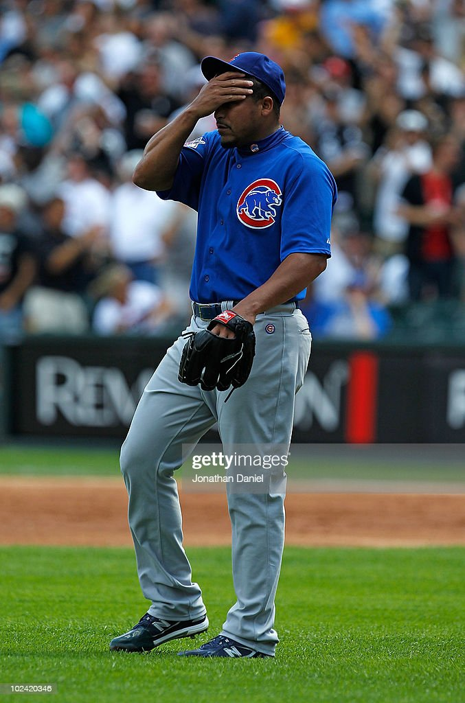 Starting pitcher <a gi-track='captionPersonalityLinkClicked' href=/galleries/search?phrase=Carlos+Zambrano&family=editorial&specificpeople=203225 ng-click='$event.stopPropagation()'>Carlos Zambrano</a> #38 of the Chicago Cubs reacts after giving up a three-run home run in the 1st inning to Carlos Quentin of the Chicago White Sox at U.S. Cellular Field on June 25, 2010 in Chicago, Illinois. Zambrano was suspended indefinitely by the Cubs for an outburst in the dugout after the 1st inning. The White Sox defeated the Cubs 6-0.