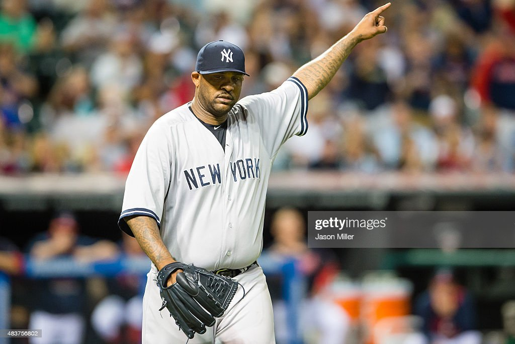 Starting pitcher CC Sabathia #52 of the New York Yankees celebrates after shortstop Didi Gregorius #18 threw out Mike Aviles #4 of the Cleveland Indians to end the top of the sixth inning at Progressive Field on August 12, 2015 in Cleveland, Ohio.