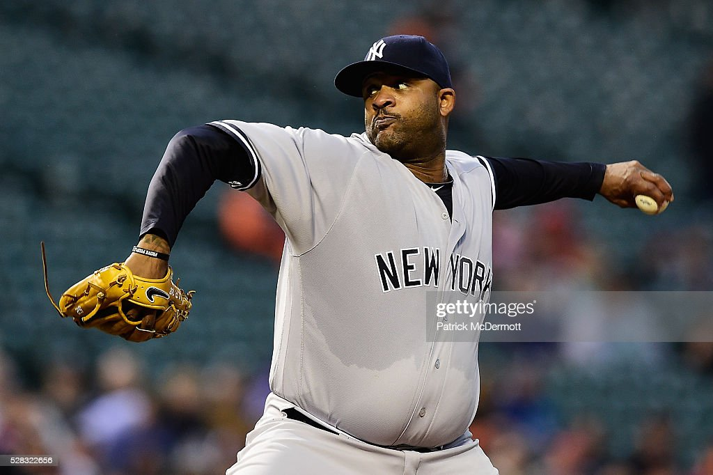Starting pitcher CC Sabathia #52 of the New York Yankees throws a pitch to a Baltimore Orioles batter in the first inning during a baseball game at Oriole Park at Camden Yards on May 4, 2016 in Baltimore, Maryland.