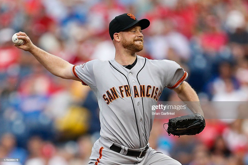 Starting pitcher <a gi-track='captionPersonalityLinkClicked' href=/galleries/search?phrase=Chad+Gaudin&family=editorial&specificpeople=3011132 ng-click='$event.stopPropagation()'>Chad Gaudin</a> #57 of the San Francisco Giants throws a pitch during the game against the Philadelphia Phillies at Citizens Bank Park on July 31, 2013 in Philadelphia, Pennsylvania.
