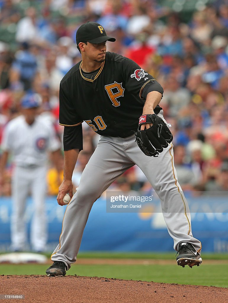 Starting pitcher Charlie Morton #50 of the Pittsburgh Pirates delivers the ball against the Chicago Cubs at Wrigley Field on July 6, 2013 in Chicago, Illinois.