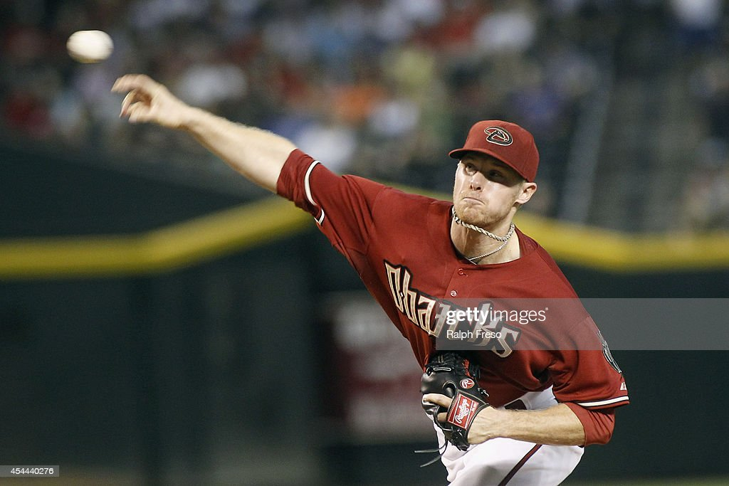 Starting pitcher Chase Anderson #57 of the Arizona Diamondbacks delivers a pitch against the Colorado Rockies during the first inning of a MLB game at Chase Field on August 31, 2014 in Phoenix, Arizona.
