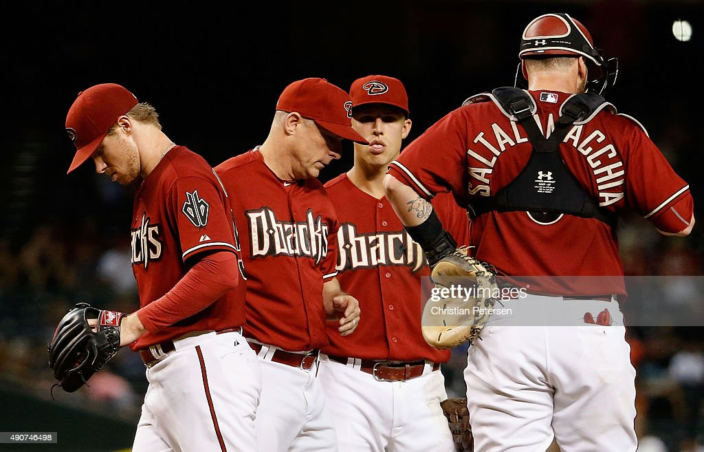 Starting pitcher Chase Anderson #57 of the Arizona Diamondbacks is removed by manager Chip Hale during the sixth inning of the MLB game against the Colorado Rockies at Chase Field on September 30, 2015 in Phoenix, Arizona.