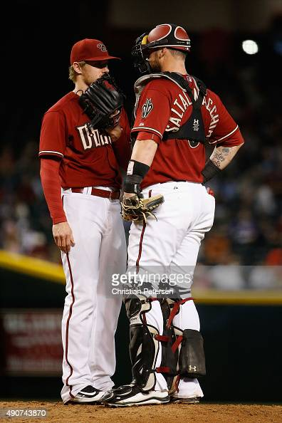 Starting pitcher Chase Anderson of the Arizona Diamondbacks talks with catcher Jarrod Saltalamacchia on the mound during the third inning of the MLB...