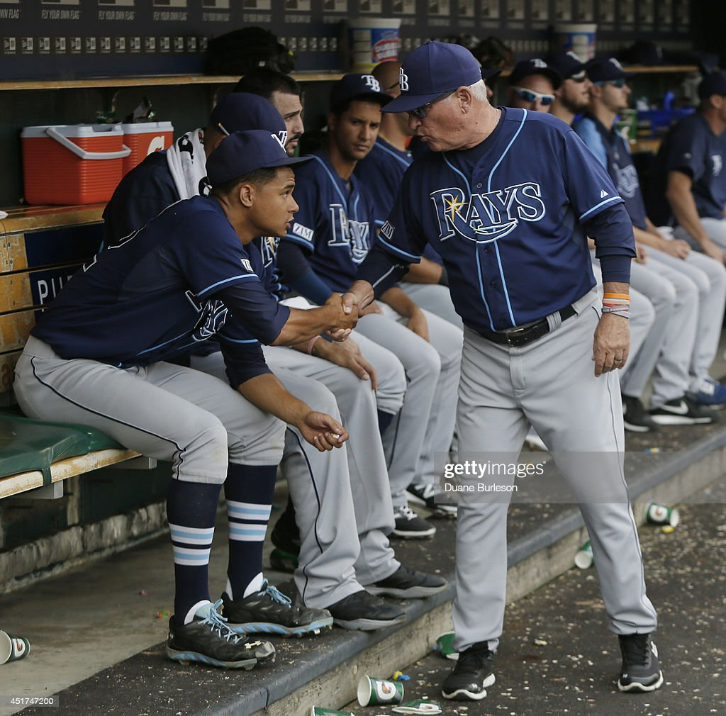 Starting pitcher Chris Archer #22 of the Tampa Bay Rays is congratulated by manager Joe Maddon #70 during the ninth inning of a 7-2 win over the Detroit Tigers at Comerica Park on July 5, 2014 in Detroit, Michigan. Archer pitched into the ninth inning to record his 5th win of the season.