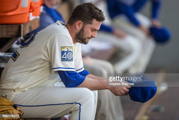 Starting pitcher Chris Heston of the Seattle Mariners sits in the dugout after being pulled from the game against the Chicago White Sox in the fourth...