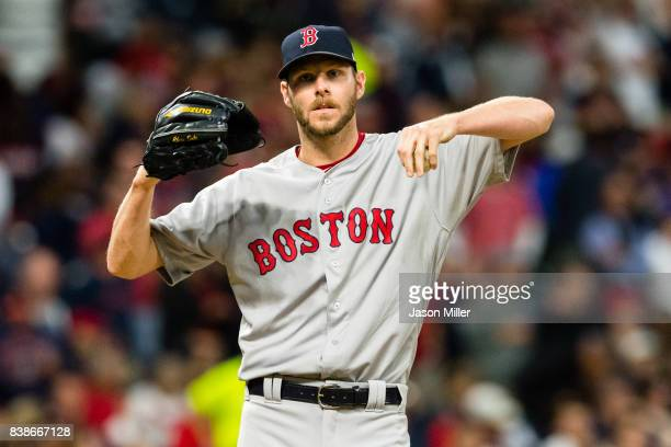 Starting pitcher Chris Sale of the Boston Red Sox reacts after giving up a hit during the third inning against the Cleveland Indians at Progressive...