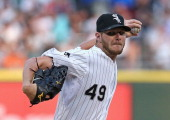 Starting pitcher Chris Sale of the Chicago White Sox delivers the ball against the Kansas City Royals at US Cellular Field on July 21 2014 in Chicago...