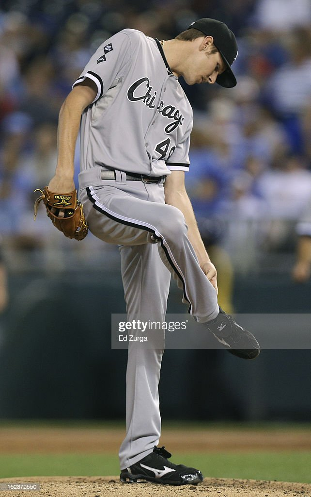 Starting pitcher <a gi-track='captionPersonalityLinkClicked' href=/galleries/search?phrase=Chris+Sale&family=editorial&specificpeople=7132181 ng-click='$event.stopPropagation()'>Chris Sale</a> #49 of the Chicago White Sox looks down at his foot after he was struck by a ball hit by Alcides Escobar of the Kansas City Royals in the third inning at Kauffman Stadium on September 19, 2012 in Kansas City, Missouri.