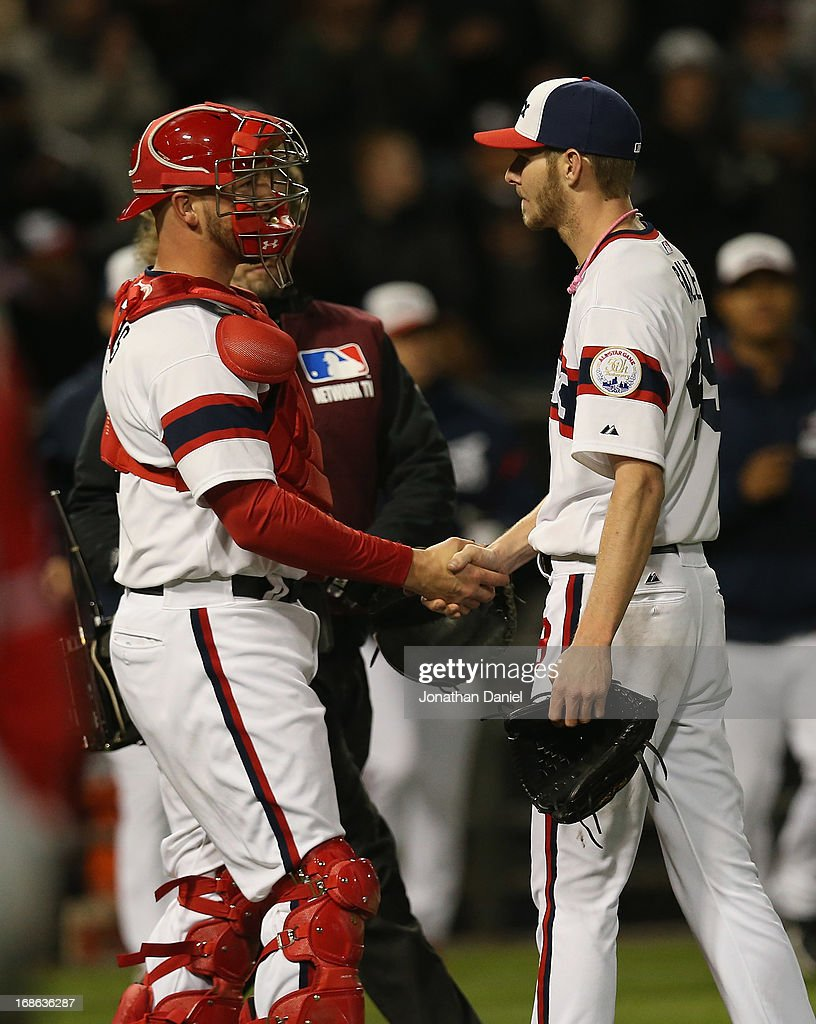 Starting pitcher Chris Sale #49 of the Chicago White Sox shakes hands with Tyler Flowers #21 after his one-hit shutout of the Los Angeles Angels of Anaheim at U.S. Cellular Field on May 12, 2013 in Chicago, Illinois. The White Sox defeated the Angels 3-0.