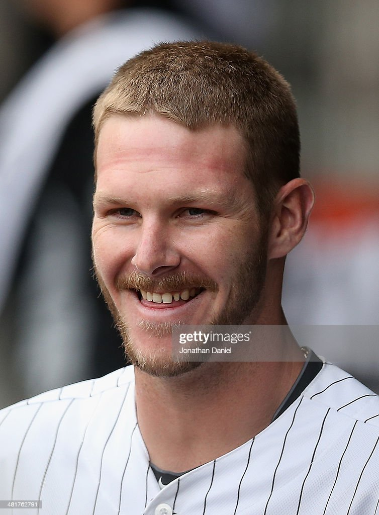 Starting pitcher Chris Sale of the Chicago White Sox smiles at a teammate in the dugout after being taken out in the 8th inning against the Minnesota...