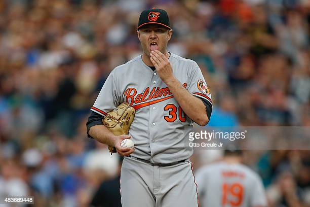 Starting pitcher Chris Tillman of the Baltimore Orioles pauses on the mound after giving up a solo home run to Nelson Cruz of the Seattle Mariners in...