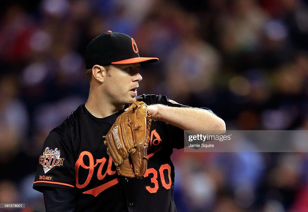 Starting pitcher <a gi-track='captionPersonalityLinkClicked' href=/galleries/search?phrase=Chris+Tillman&family=editorial&specificpeople=713179 ng-click='$event.stopPropagation()'>Chris Tillman</a> #30 of the Baltimore Orioles reacts during the game against the Kansas City Royals at Kauffman Stadium on May 16, 2014 in Kansas City, Missouri.