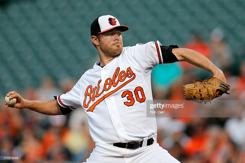 Starting pitcher Chris Tillman #30 of the Baltimore Orioles throws to a Cleveland Indians batter during the second inning at Oriole Park at Camden Yards on June 25, 2013 in Baltimore, Maryland.