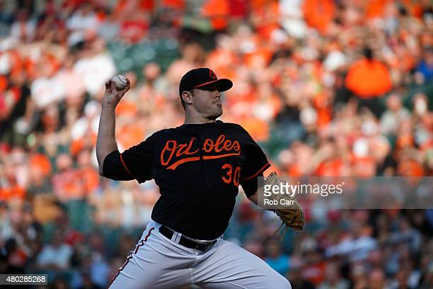 Starting pitcher Chris Tillman of the Baltimore Orioles throws to a Washington Nationals batter in the first inning at Oriole Park at Camden Yards on...