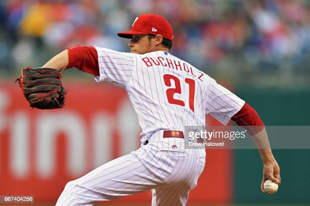 Starting pitcher Clay Buchholz of the Philadelphia Phillies delivers a pitch in the first inning against the New York Mets at Citizens Bank Park on...