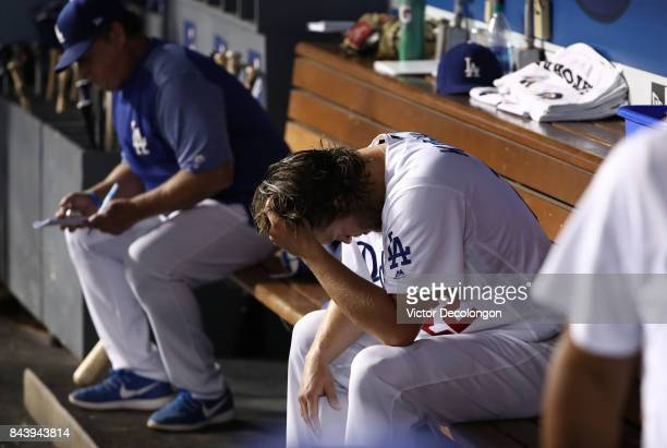 Starting pitcher Clayton Kershaw of the Los Angeles Dodgers holds his head in this hand shortly after leaving the game in the fourth inning during...