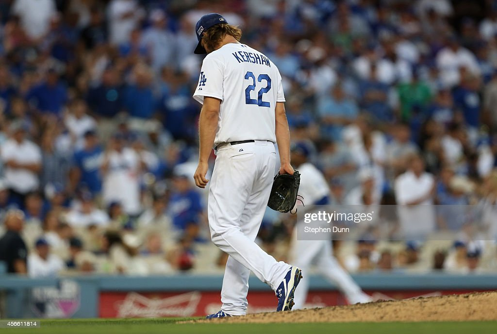 Starting pitcher Clayton Kershaw of the Los Angeles Dodgers leaves the field after being relieved during the seventh inning of Game One of the...