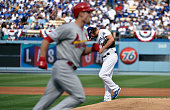 Starting pitcher Clayton Kershaw of the Los Angeles Dodgers reacts after Randal Grichuk of the St Louis Cardinals hits a homerun in the first inning...