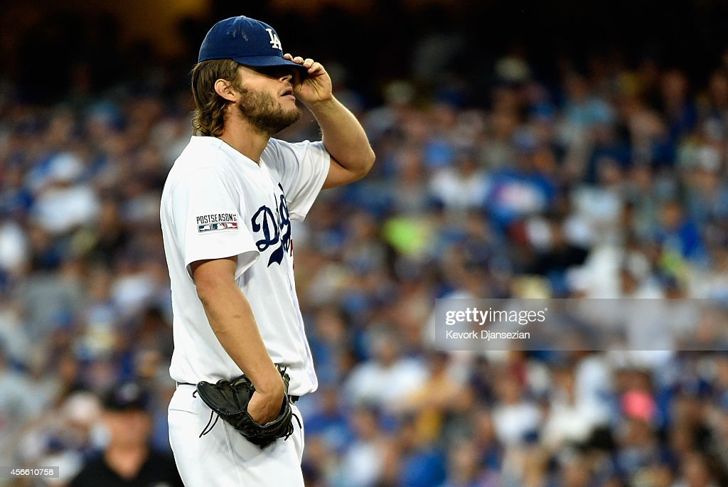 Starting pitcher Clayton Kershaw of the Los Angeles Dodgers reacts after giving up a base hits a to Jhonny Peralta of the St Louis Cardinals in the...