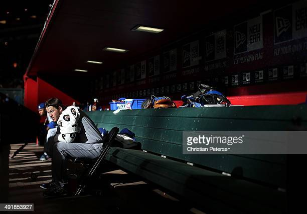 Starting pitcher Clayton Kershaw of the Los Angeles Dodgers sits in the dugout before start of the MLB game against the Arizona Diamondbacks at Chase...