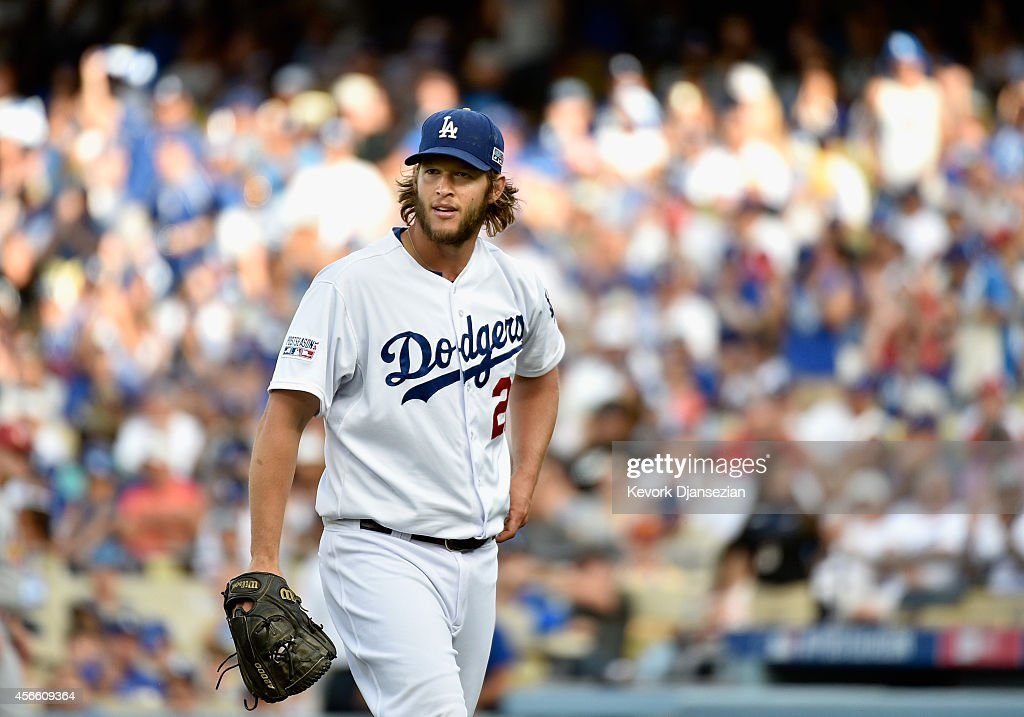Starting pitcher Clayton Kershaw of the Los Angeles Dodgers walks back to the mound after striking out Jhonny Peralta of the St Louis Cardinals in...