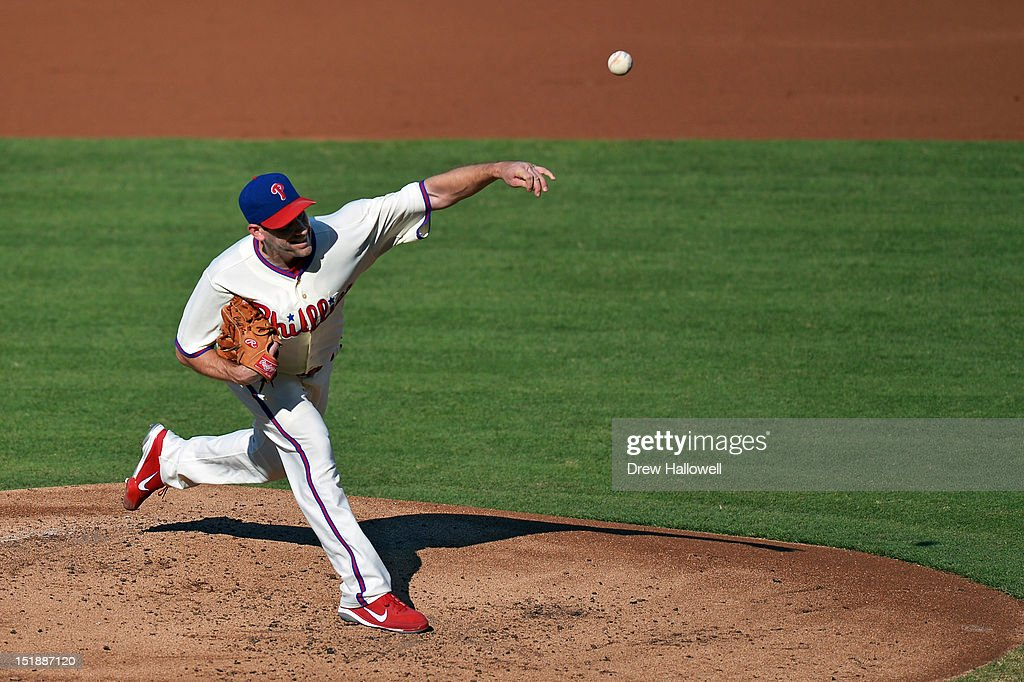 Starting pitcher <a gi-track='captionPersonalityLinkClicked' href=/galleries/search?phrase=Cliff+Lee&family=editorial&specificpeople=218092 ng-click='$event.stopPropagation()'>Cliff Lee</a> #33 of the Philadelphia Phillies delivers a pitch during the game against the Miami Marlins at Citizens Bank Park on September 12, 2012 in Philadelphia, Pennsylvania.