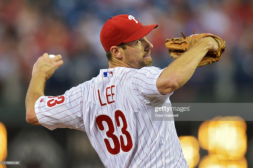 Starting pitcher <a gi-track='captionPersonalityLinkClicked' href=/galleries/search?phrase=Cliff+Lee&family=editorial&specificpeople=218092 ng-click='$event.stopPropagation()'>Cliff Lee</a> #33 of the Philadelphia Phillies delivers a pitch in the first inning against the Atlanta Braves at Citizens Bank Park on August 4, 2013 in Philadelphia, Pennsylvania.