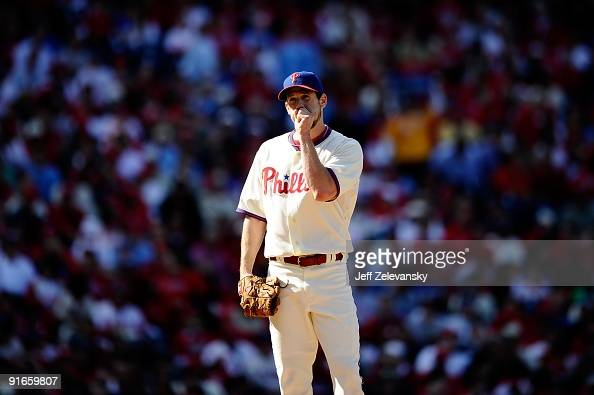 Starting pitcher Cliff Lee of the Philadelphia Phillies gets set to throw a pitch against the Colorado Rockies in Game One of the NLDS during the...