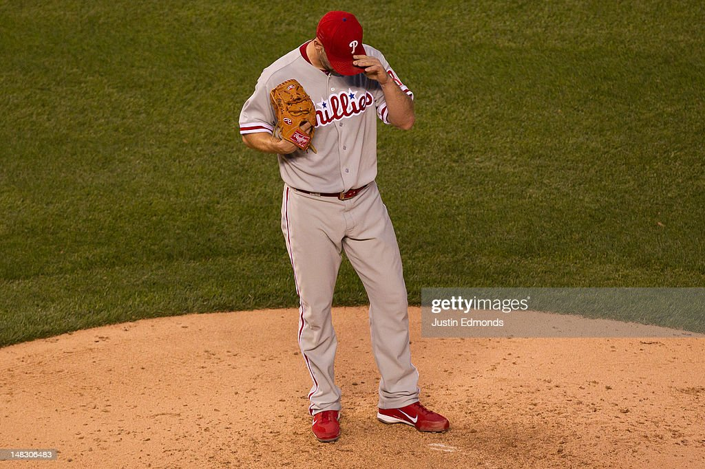 Starting pitcher <a gi-track='captionPersonalityLinkClicked' href=/galleries/search?phrase=Cliff+Lee&family=editorial&specificpeople=218092 ng-click='$event.stopPropagation()'>Cliff Lee</a> #33 of the Philadelphia Phillies reacts after allowing the go-ahead run in the sixth inning against the Colorado Rockies at Coors Field on July 13, 2012 in Denver, Colorado.