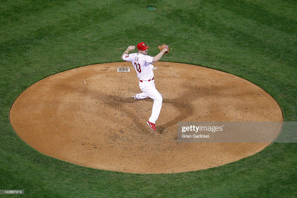 Starting Pitcher <a gi-track='captionPersonalityLinkClicked' href=/galleries/search?phrase=Cliff+Lee&family=editorial&specificpeople=218092 ng-click='$event.stopPropagation()'>Cliff Lee</a> #33 of the Philadelphia Phillies throws a pitch during the game against the New York Mets at Citizens Bank Park on April 13, 2012 in Philadelphia, Pennsylvania. The Mets won 5-2.