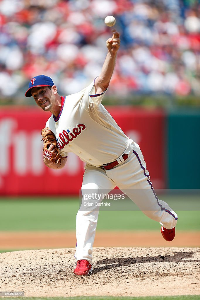 Starting pitcher <a gi-track='captionPersonalityLinkClicked' href=/galleries/search?phrase=Cliff+Lee&family=editorial&specificpeople=218092 ng-click='$event.stopPropagation()'>Cliff Lee</a> #33 of the Philadelphia Phillies throws a pitch during the game against the Washington Nationals at Citizens Bank Park on August 26, 2012 in Philadelphia, Pennsylvania.