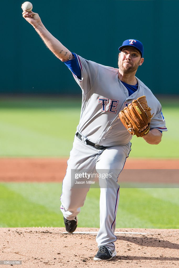 Starting pitcher <a gi-track='captionPersonalityLinkClicked' href=/galleries/search?phrase=Colby+Lewis&family=editorial&specificpeople=834318 ng-click='$event.stopPropagation()'>Colby Lewis</a> #48 of the Texas Rangers during the first inning against the Cleveland Indians at Progressive Field on May 31, 2016 in Cleveland, Ohio.