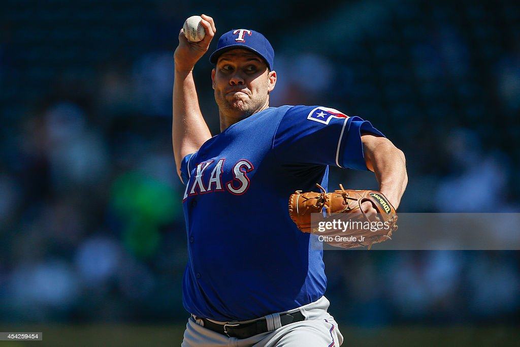 Starting pitcher Colby Lewis #48 of the Texas Rangers pitches in the second inning against the Seattle Mariners at Safeco Field on August 27, 2014 in Seattle, Washington.