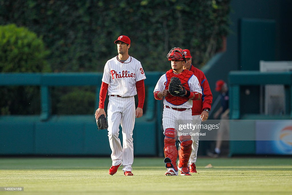 Starting pitcher Cole Hamels #35 of the Philadelphia Phillies and Carlos Ruiz #51 enter the field before the game against the Boston Red Sox at Citizens Bank Park on May 18, 2012 in Philadelphia, Pennsylvania. The Phillies won 6-4.