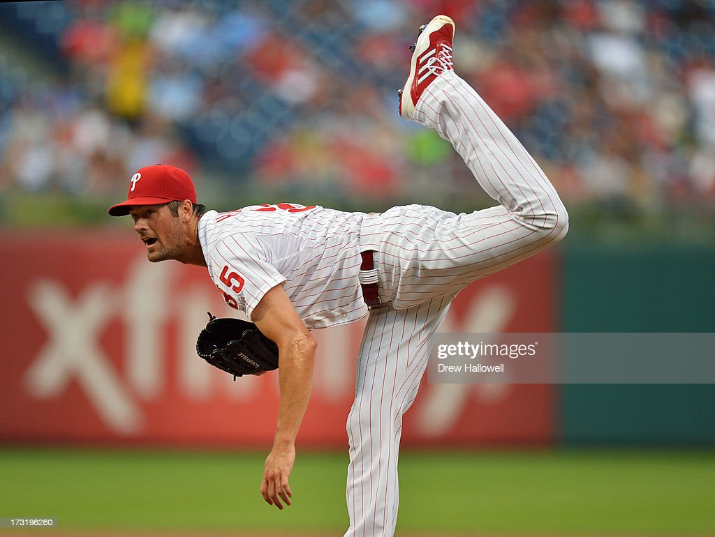 Starting pitcher <a gi-track='captionPersonalityLinkClicked' href=/galleries/search?phrase=Cole+Hamels&family=editorial&specificpeople=565675 ng-click='$event.stopPropagation()'>Cole Hamels</a> #35 of the Philadelphia Phillies follows through on a pitch in the first inning against the Washington Nationals at Citizens Bank Park on July 9, 2013 in Philadelphia, Pennsylvania.