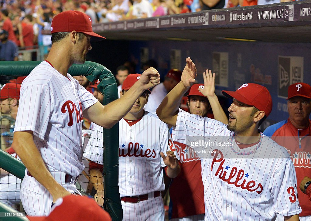 Starting pitcher <a gi-track='captionPersonalityLinkClicked' href=/galleries/search?phrase=Cole+Hamels&family=editorial&specificpeople=565675 ng-click='$event.stopPropagation()'>Cole Hamels</a> #35 of the Philadelphia Phillies is congratulated by teammate Mike Adams #37 after getting out of the eighth inning against the Washington Nationals at Citizens Bank Park on July 9, 2013 in Philadelphia, Pennsylvania. The Phillies won 4-2.